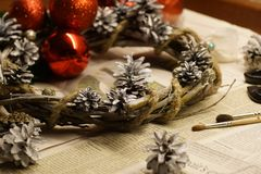 The process of making a Christmas wreath with his own hands. Advent wreath, or Advent crown, is a Christian tradition. Christmas preparations. The process of stock images
