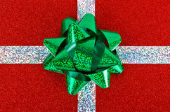 Christmas present. A red Christmas present with green bow Stock Photo