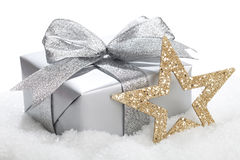 Christmas Present. Is lying in snow - isolated on a white background Royalty Free Stock Photo