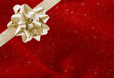 Christmas Present. A red Christmas present with a gold bow and ribbon, merry Christmas Stock Photos