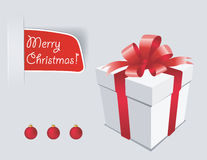 Christmas Present. Gift box with red bow isolated on white Royalty Free Stock Photos
