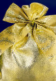 Christmas present. Golden christmas present bag with bow Royalty Free Stock Images