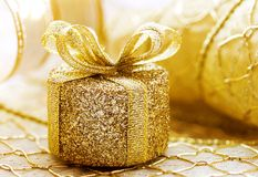 Christmas present. Tiny golden present Royalty Free Stock Photos