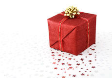 Christmas present. Red Christmas box on white background with tiny silver stars Royalty Free Stock Photo