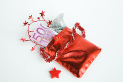 Christmas present, Advent calendar, small bag with money. On white background Royalty Free Stock Images