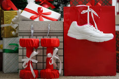 Christmas present. Athletic shoes for running, dumbbells fitness Royalty Free Stock Photo