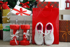 Christmas present. Athletic shoes for running, dumbbells fitness Stock Photo