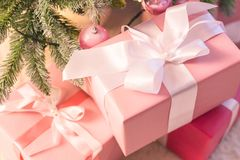A Christmas present for the baby. Beautiful box with ribbon. Soft focus. stock photo