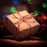 Christmas present on the background of Christmas lights. Photo with copy space Stock Photography