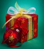 Christmas present and ball Stock Image