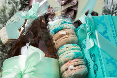 Christmas present in basket with  pastry, wine, decor Royalty Free Stock Image