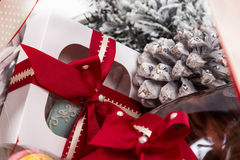 Christmas present in basket with  pastry, wine, decor Stock Photo