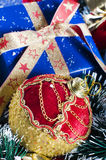 Christmas present and bauble Royalty Free Stock Images