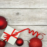 Christmas Present and Baubles Stock Image