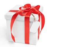 Christmas present with blank tag Royalty Free Stock Images