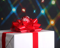 Christmas present with bow and ornament Stock Photos
