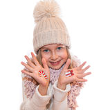 Christmas present box and Christmas lolly painted on kid's hand Stock Image