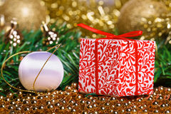 Christmas present box with yellow beads and white Royalty Free Stock Images