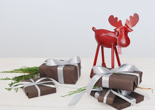 Christmas present boxes and deer on white wood background Stock Photos