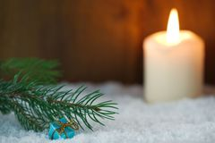 Christmas present with burning candle. And Christmas tree branch Stock Photos