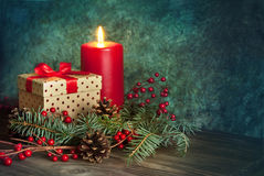 Christmas present and candle Stock Photography