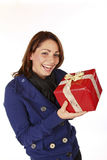 Christmas Present Cheer. Cute Cheerful Young Woman With Her Christmas Present Stock Photo