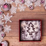 Christmas present concept with xmas tree drawing in flour on gif Royalty Free Stock Photo