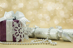Christmas Present with cracker. Beautifully wrapped present with silver snowflake and christmas cracker Stock Photos