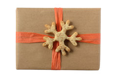 Christmas present decorated with cookie snowflake Royalty Free Stock Photos