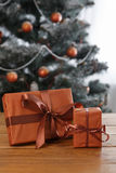 Christmas present on decorated tree background, holiday concept Stock Images