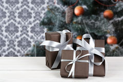 Christmas present on decorated tree background, holiday concept Royalty Free Stock Photography
