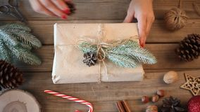 Christmas present decoration. Handmade decor concept. Woman wrapping gift box on the wooden table. Christmas present decoration. Handmade decor concept. Woman stock video footage