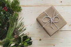 Christmas present with festive foliage Royalty Free Stock Photos