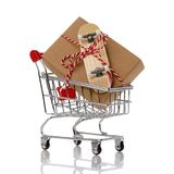 Christmas present, fingerboard in a cart. Isolated on a white background Royalty Free Stock Photo