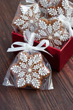Christmas present in gift box, gingerbread cookies Royalty Free Stock Images