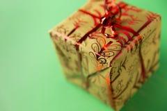 Christmas present gift box on green background. Closeup shot of Xmas present box Stock Image