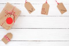 Christmas present gift boxe with tags. On white wooden background. Creative flat lay, top view design Stock Image