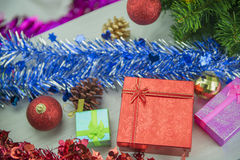 Christmas present gift boxes on wood floor. Merry Christmas and Happy New Year. Royalty Free Stock Image