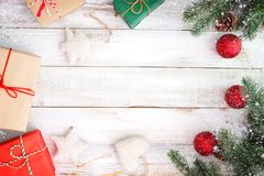 Christmas present gifts box and decorating elements on white wooden background with snowflake stock photos