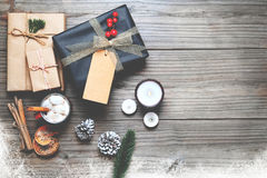 Christmas present gifts box and rustic decoration on vintage wooden background Stock Photography