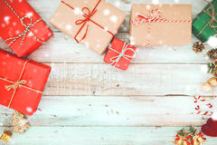 Christmas present gifts box and snow on wooden background Stock Photography