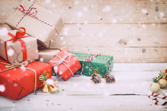Christmas present gifts box and snow on wooden background Stock Photos