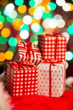 Christmas present and gifts with lights at the background Royalty Free Stock Image
