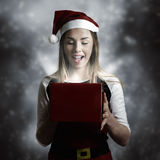 Christmas present girl opening magic gift box Royalty Free Stock Photo