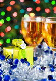 Christmas present and glasses of white wine Royalty Free Stock Photography