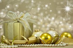 Christmas Present with gold baubles.. Royalty Free Stock Photos