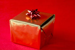 Christmas present in gold Royalty Free Stock Image