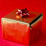 Christmas present in gold Royalty Free Stock Photo