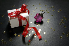 Christmas present with gold shine stars and bauble Royalty Free Stock Photo