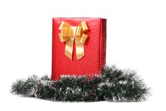 Christmas present with golden ribbon. Royalty Free Stock Image